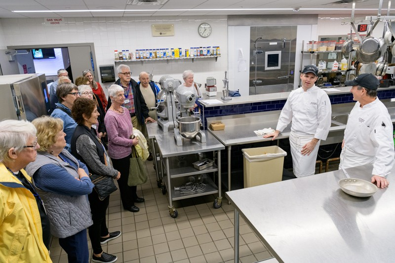 A class from UD's Osher Lifelong Learning Institute (OLLI) program visits UD's Vita Nova kitchen with a tour led by Vita Nova chef-instructors John Deflieze and Joe DiGregorio.