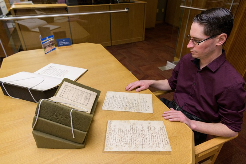 Scottish hero Robert Burns was going to use the earnings from his first book to relocate to Jamaica, because he didn't think he'd be able to make a living off his poetry at home, said librarian Alex Johnston, pictured here with a first-edition copy. But the collection shot Burns to superstardom status in Scotland and abroad.
