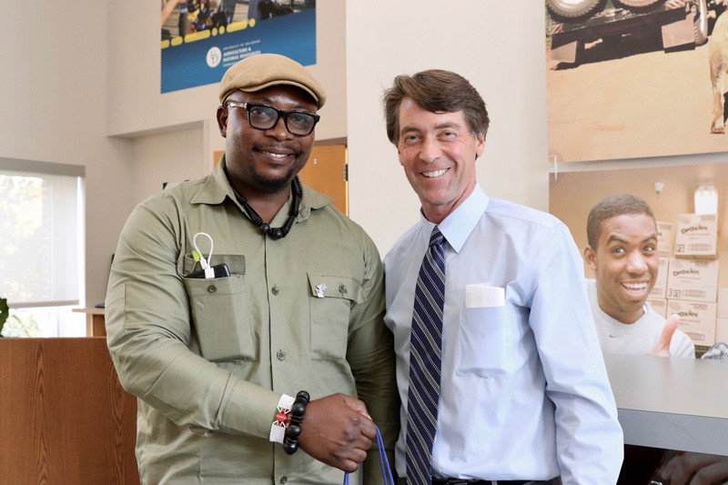 Adams Cassinga (left), a 2017 alumnus of the UD Mandela Washington Fellowship, meets with Mark Rieger, dean of UD's College of Agriculture and Natural Resources (CANR).