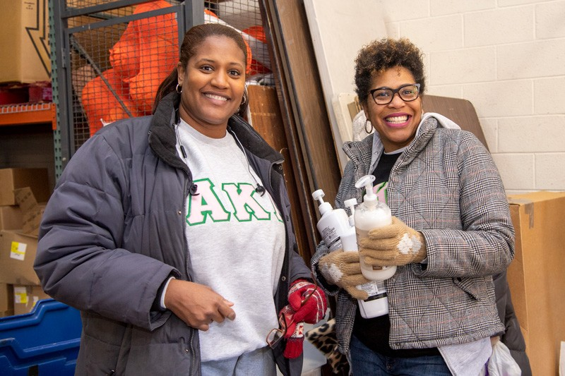 """Volunteering on Martin Luther King, Jr. Day is great,"" said Kimberly Reid (right), a UD graduate and member of the Alpha Kappa Alpha Zeta Omega graduate chapter. ""But it's just as important to honor King's legacy next week and the week after that."" Here, Reid is pictured with sorority sister Glenda Gilchrist-Pinkett."