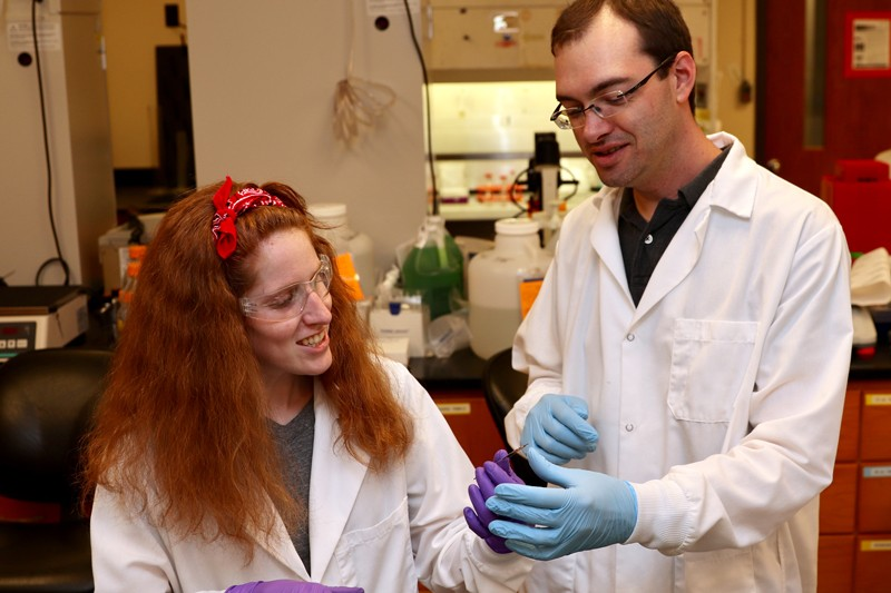 Casey Johnson (left), who is pursuing her doctoral degree, and her adviser, Prof. Ryan Arsenault, are investigating poultry diseases at the molecular level.