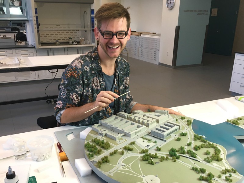 Riley Cruttenden, who will begin the Winterthur/UD Program in Art Conservation in August, works on restoring and preserving a model of a city.
