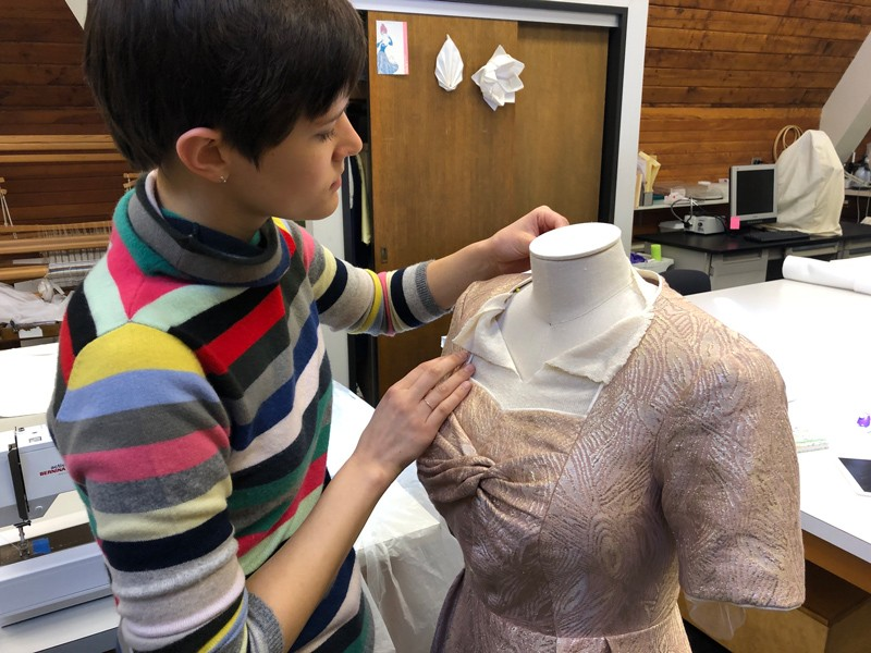 "Annabelle Camp, an art conservation student specializing in textiles, works on a dress for the Winterthur Museum's 2019-20 costume exhibition based on the TV series ""The Crown."""