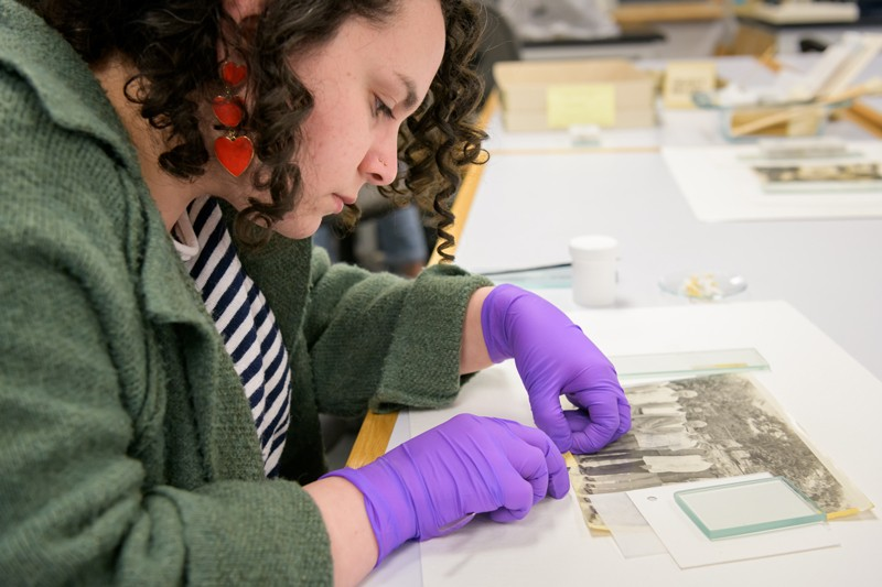 Abigail Rodriguez, an art conservation graduate student, helps to preserve a collection of photographs of iconic Puerto Rican boxers owned by The House of the Boxer, a nonprofit that celebrates the rich history of boxing on the island. UD students worked on this project in January.