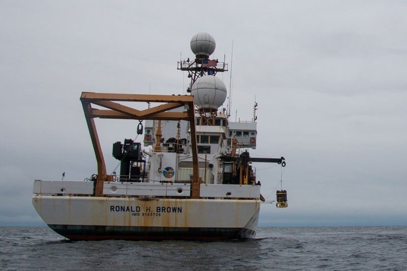 Scientists aboard the NOAA Ship Ronald H. Brown collect water samples using a CTD (conductivity, temperature, depth) rosette. Research cruises during this study collected water samples to obtain a snapshot of key carbon, physical, biological and chemical conditions in the ocean.