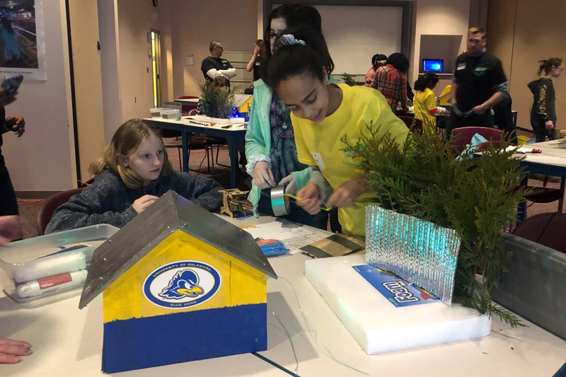 Middle School students create their own environmental buffer for a miniature poultry house built by Extension poultry agent Georgie Cartanza.