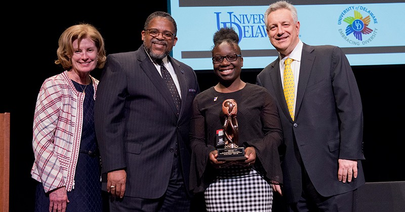 Before the coronavirus (COVID-19) pandemic made social distancing essential, UD junior Melissa Lewis was honored with the 2020 Louis L. Redding Diversity Award. Joining her at the ceremony are (left to right) Provost Robin Morgan, Interim Vice Provost for Diversity and Inclusion Michael Vaughan and President Dennis Assanis.