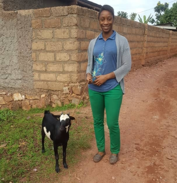 Leah Putman poses with a goat she gave to a neighbor in Rwanda. Putman works in the country as the Technical Director for Sustainable Health Enterprises.