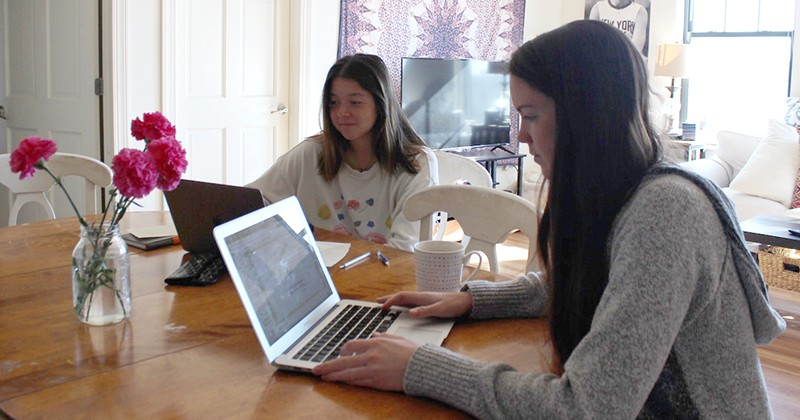 UD business students and roommates Hannah Fuss and Cecilia Iverson work on the international marketing project together in their apartment using Zoom.