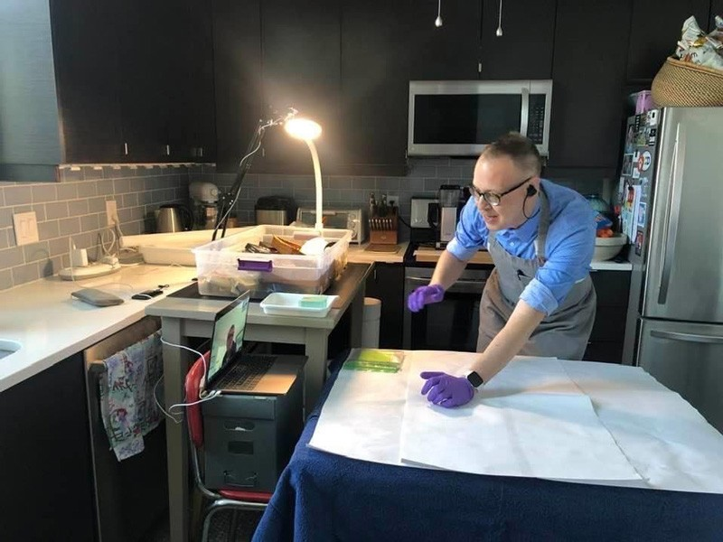 During the spring semester, William Donnelly, affiliated assistant professor of art conservation, turned his kitchen into a teaching space. Here, he facilitates an exercise where students, tuned in via Zoom, talk him through the recovery of wet artifacts from large, plastic tubs of water.