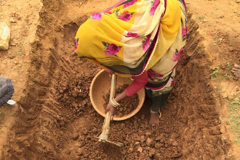 Artisanal diamond mining is done by individuals who use manual tools to dig shallow pits into the ground and then sieve through the gravel to find diamonds.