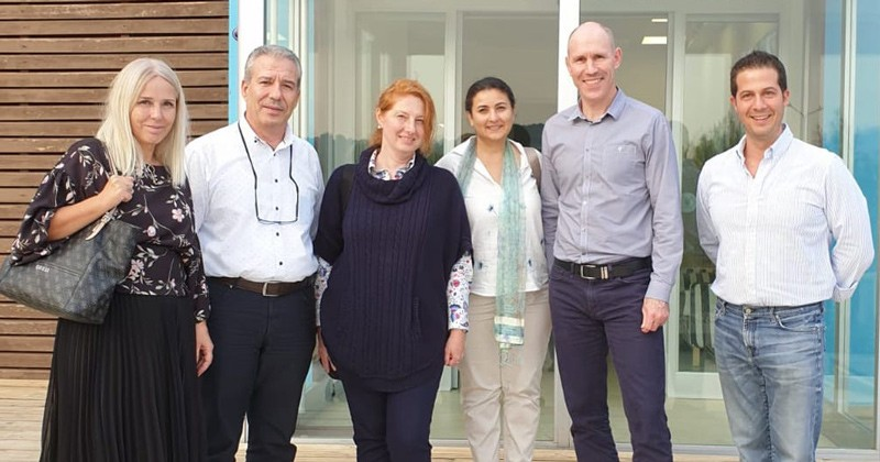 UD alumna Patricia Westenbroek (third from left) visits FloraBio A.S., a biotechnology company at the Izmir Institute of Technology (IYTE) Technopark in Turkey.  From left to right are Sevil Erdenlig of Harran University, Ekrem Özdemir of IYTE, Westenbroek, Ferda Soyer of IYTE, John McGiven of Pirbright Laboratory, UK and O.Cem Erdem of FloraBio.