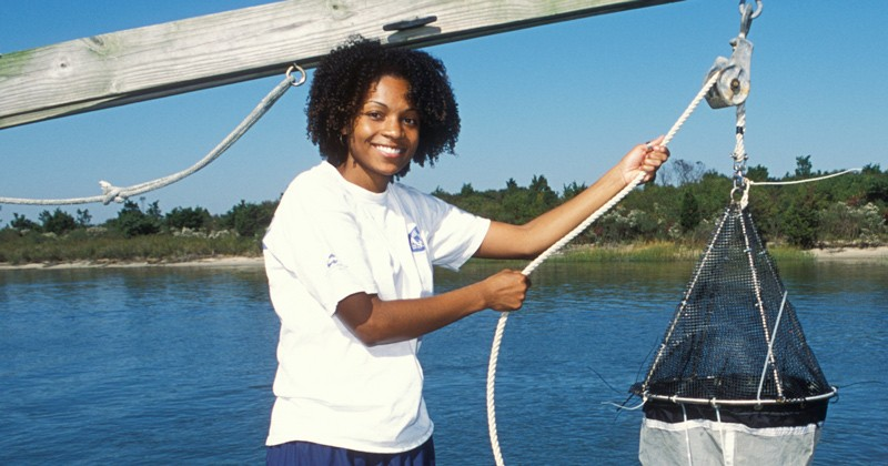 Letise LaFeir pictured during her time at UD conducting a plankton tow off of a pier at UD's Hugh R. Sharp Campus in Lewes, Delaware.